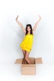 Woman in box Stock Photo