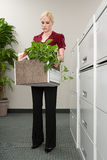 Woman with box of belongings stock photography