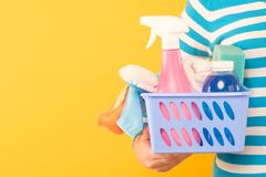 Woman box cleaning products sponges yellow stock photography