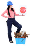 Woman with box of debris Stock Photography