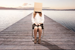 Woman with a box in her face Stock Photography