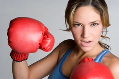 Woman Boxer. Young angry fitness woman boxer Stock Photos