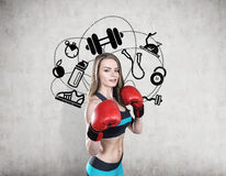 Woman boxer in blue and icons Stock Photos