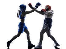 Woman boxer boxing man kickboxing silhouette isolated Royalty Free Stock Photography