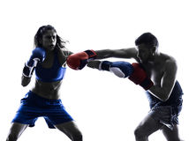 Woman boxer boxing man kickboxing silhouette Stock Images