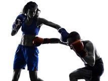 Woman boxer boxing man kickboxing silhouette  Stock Photography