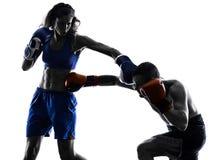 Woman boxer boxing man kickboxing silhouette  Stock Photography