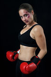 Woman boxer with bruises Royalty Free Stock Photography