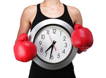 Woman boxer with a clock Stock Photos