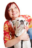 Woman and boxer dog looking up Stock Photography