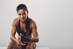 Woman boxer getting ready for workout Stock Images