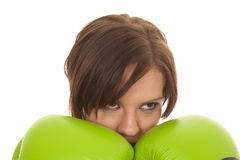 Woman boxer green gloves face Stock Images