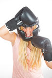 Woman boxer. Woman with helmet and gloves-boxing king Stock Image