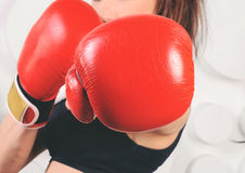 Woman boxer hit straight at the camera Royalty Free Stock Photography