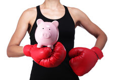 Woman boxer with a piggy bank stock photography