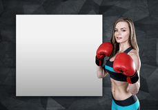 Woman boxer and poster Royalty Free Stock Photography