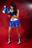Woman boxer preparing to fight. Royalty Free Stock Image