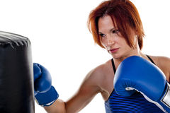 Woman Boxer with Punching Bag Royalty Free Stock Photos