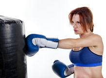 Woman Boxer with Punching Bag Royalty Free Stock Image