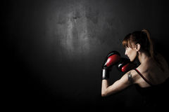 Woman Boxer with Red Gloves on Black Backgound Royalty Free Stock Photography