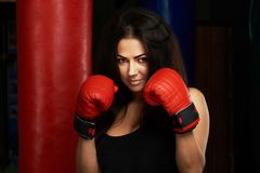 Woman boxer in red gloves Royalty Free Stock Photos