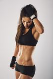 Woman boxer resting after boxing practice Stock Images