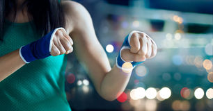 Woman boxer safety in a bandage from stretch, to train boxing pad work Stock Photography