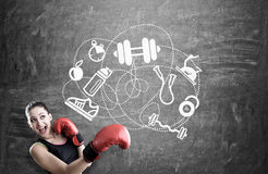 Woman boxer and sport icons on blackboard Stock Images