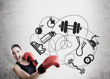 Woman boxer and sport icons on concrete wall Royalty Free Stock Photos