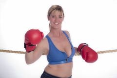 Woman boxer in sports bra and red gloves Stock Photo
