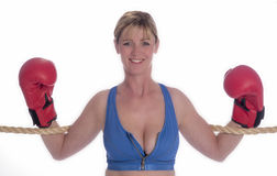 Woman boxer in sports bra and red gloves Royalty Free Stock Images