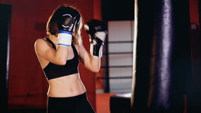 Woman boxer training in gym, boxing punching bag. stock footage