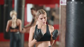 Woman boxer training punches on boxing training with coach together. stock footage