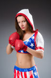 Woman boxer in uniform Stock Photography