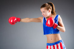 Woman boxer in uniform Stock Photo