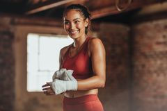 Woman getting ready for boxing practice royalty free stock image