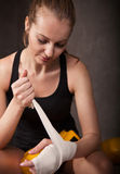 Woman boxer wearing white strap on wrist Stock Photo