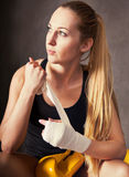 Woman boxer wearing white strap on wrist Stock Photography