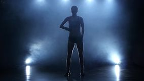 Woman boxer workout before that enters the ring. Smoky studio stock footage