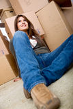 Woman with boxes moving homes Royalty Free Stock Image