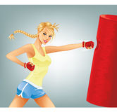 Woman Boxing. Beautiful blond fit woman boxing Royalty Free Stock Image