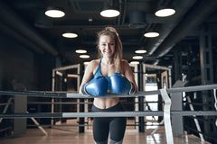 Woman boxing. Beautiful young woman while training boxing in the gym royalty free stock image