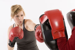 Woman boxing and exercising stock image