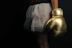 Woman in boxing glove. Over black Royalty Free Stock Photos