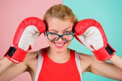 Woman boxing gloves adjust eyeglasses. Win with strength or intellect. Strong intellect victory pledge. Know how defend. Myself. Confident her power. Strong stock photo