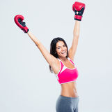 Woman in boxing gloves celebrating her success Royalty Free Stock Images