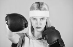 Woman boxing gloves enjoy workout. Girl learn how defend herself. Woman exercising with boxing gloves. Boxing sport royalty free stock photography