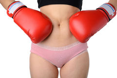 Woman with the boxing gloves fight with her belly, Diet concept Stock Photos