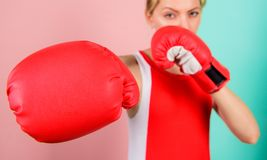 Woman boxing gloves focused on attack. Ambitious girl fight boxing gloves. Female rights. I am gonna kick you off stock images