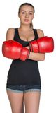 Woman in boxing gloves with her hands crossed on Royalty Free Stock Photo
